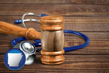 a gavel and a stethoscope - with Arkansas icon