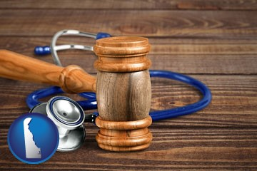 a gavel and a stethoscope - with Delaware icon