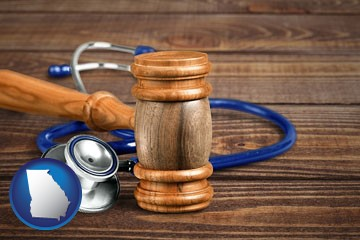 a gavel and a stethoscope - with Georgia icon