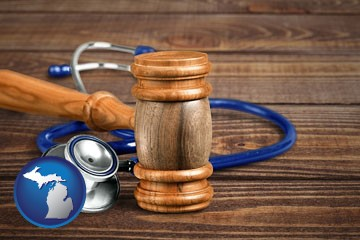 a gavel and a stethoscope - with Michigan icon