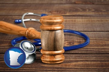 a gavel and a stethoscope - with Minnesota icon
