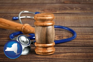 a gavel and a stethoscope - with New York icon