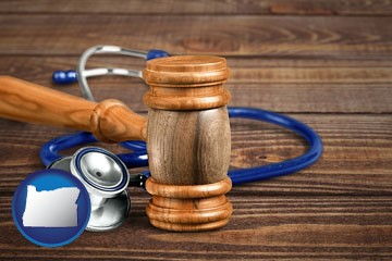 a gavel and a stethoscope - with Oregon icon