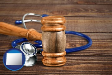 a gavel and a stethoscope - with Wyoming icon